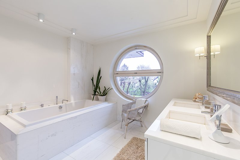 Bright bathroom with round window