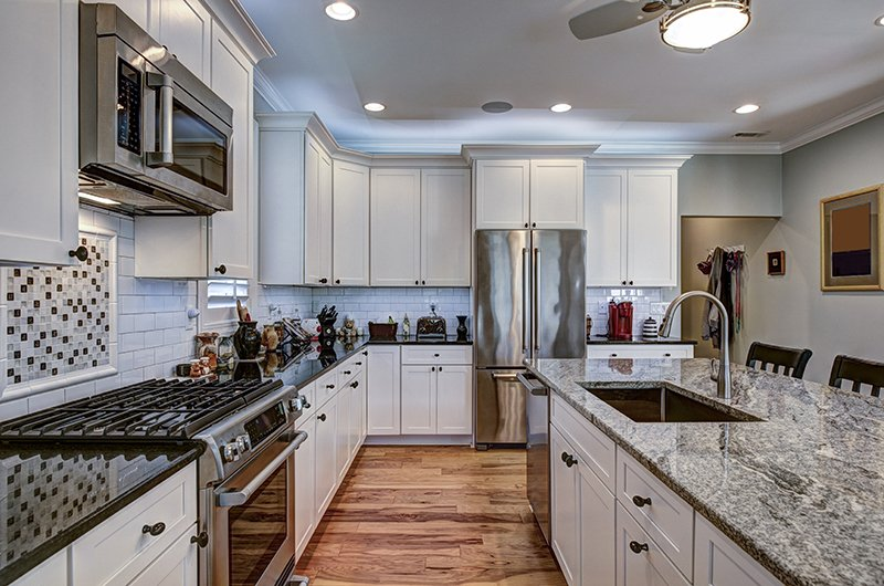 luxury kitchen with granite countertops and white cabin
