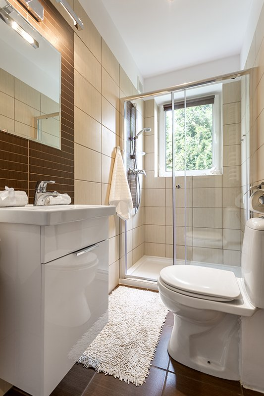 Small bathroom interior with glazed shower